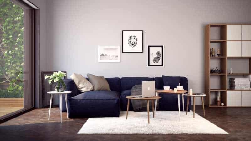 un salon avec un meuble et des tables basses mycs